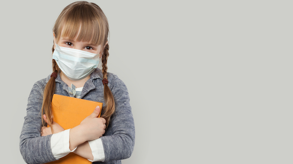 Happy child girl wearing medical protective face mask on white background
